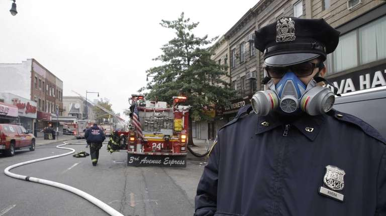 A police officer wears a mask while working