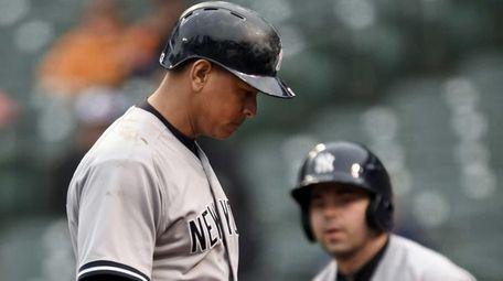 New York Yankees' Alex Rodriguez walks to the