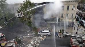 Firefighters work at the scene of an explosion