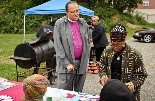 Organizer J. Raymond Mackey, left, stops at a