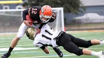 Wantagh's Dylan Beckwith puts hit on Carey's QB