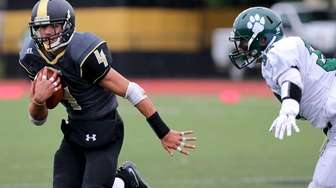 Commack RB Augie Contressa picks up the first
