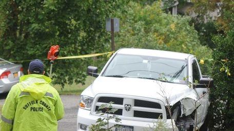 Suffolk County police crime scene investigators probe a