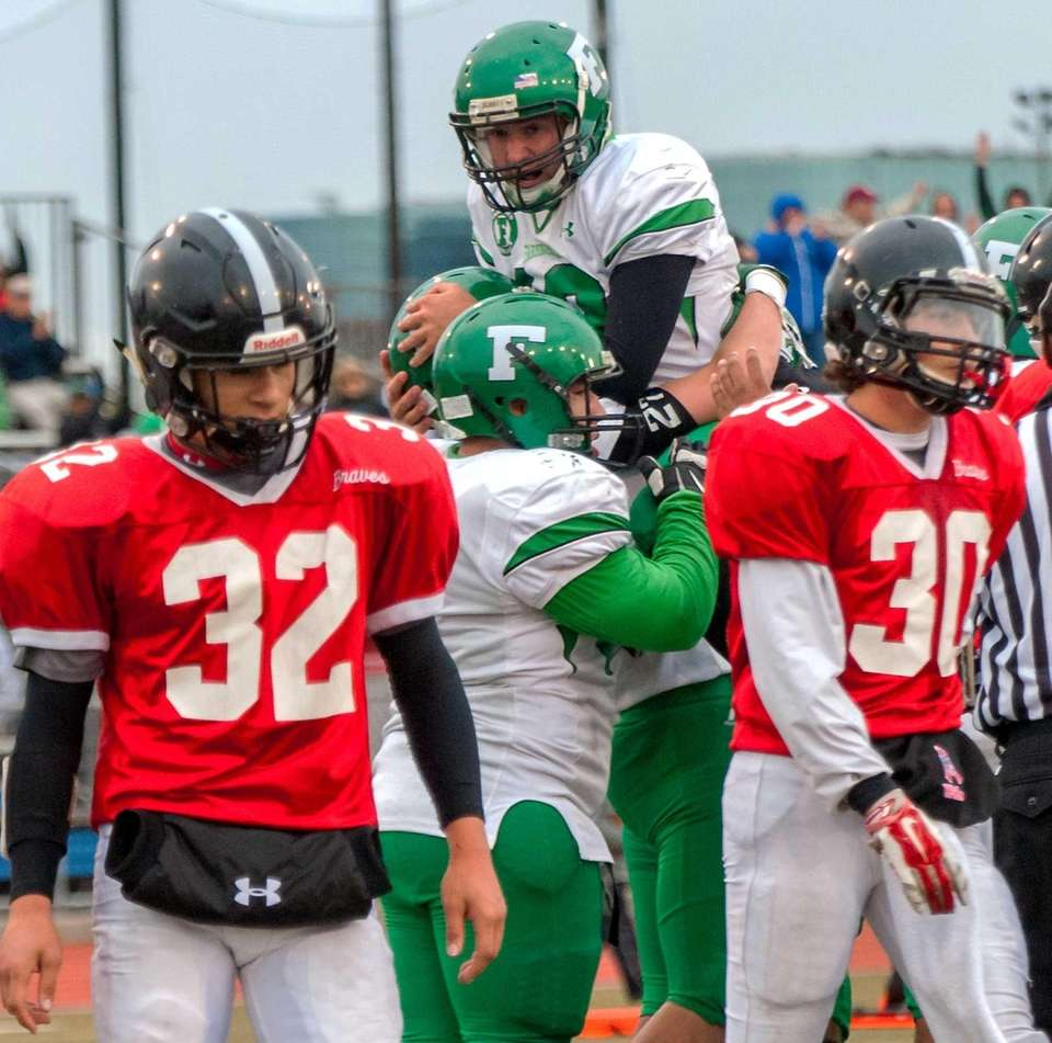 Farmingdale's QB Tommy Donovan gets congratulated after scoring