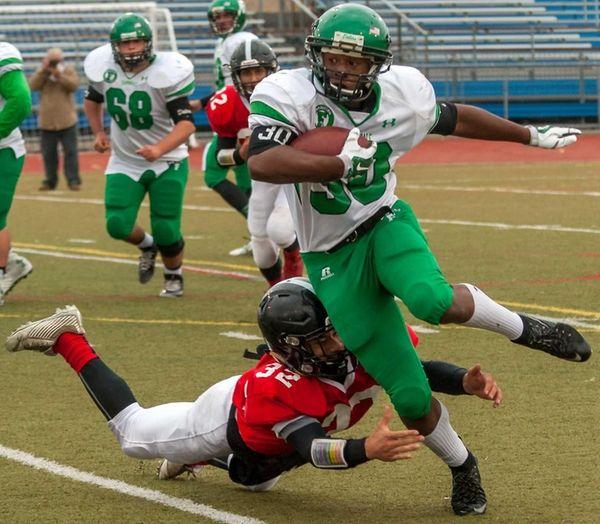 Farmingdale's Jordan Mclune runs the ball during a