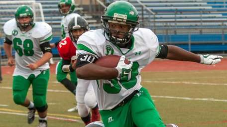 Farmingdale's Jordan Mclune runs the ball during a