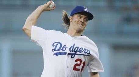 Los Angeles Dodgers starting pitcher Zack Greinke delivers
