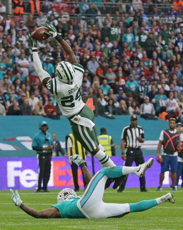 New York Jets' Darrelle Revis intercepts the ball