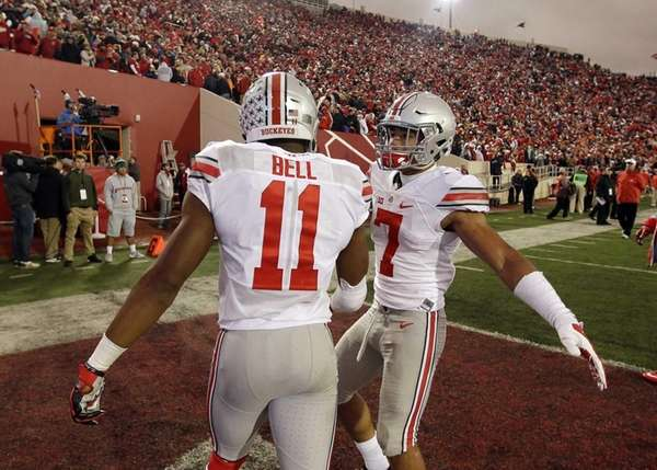 Ohio State's Vonn Bell (11) and Jalin Marshall