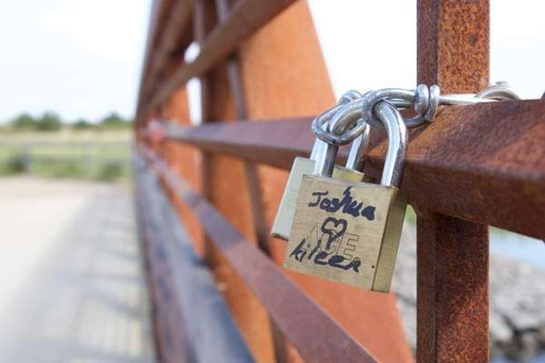 Locks are attached to a bridge at Sunken