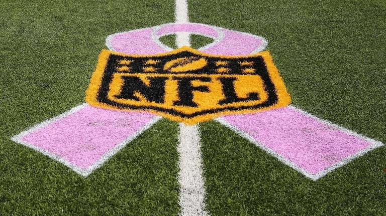 A pink ribbon under the NFL logo in