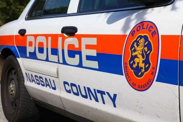 A Nassau County police car sits outside of