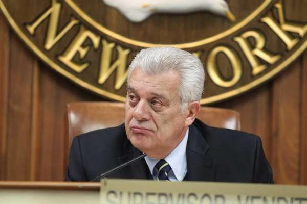 Town of Oyster Bay Supervisor John Venditto sits