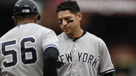 New York Yankees Jacoby Ellsbury, right, gives his