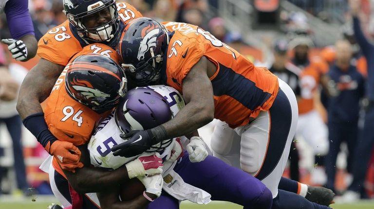 Minnesota Vikings quarterback Teddy Bridgewater (5) is sacked