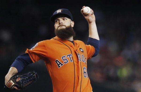 Houston Astros' Dallas Keuchel throws a pitch against