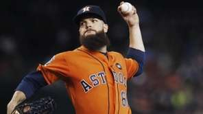 Houston Astros' Dallas Keuchel throws a pitch against