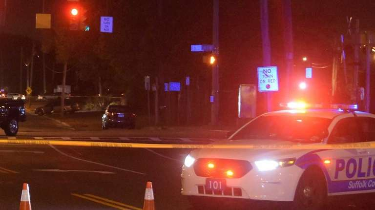 Suffolk County police at scene where a man