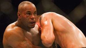 UFC light heavyweight champion Daniel Cormier, left, won