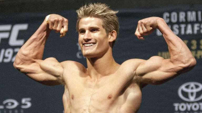 UFC fighter Sage Northcutt flexes his muscles during