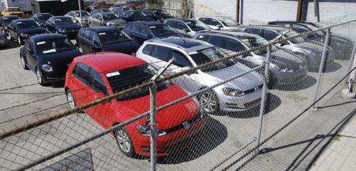 Volkswagen diesels sit behind a security fence on
