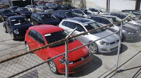 Volkswagen diesels sit behind a security fence on