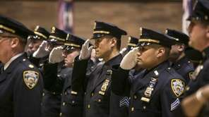 New York Police Department members salute during an