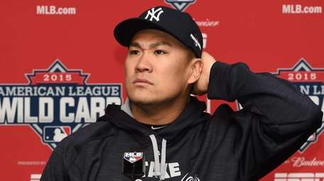 New York Yankees pitcher Masahiro Tanaka speaks with