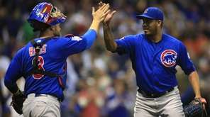 Chicago Cubs pitcher Hector Rondon, right, high-fives David