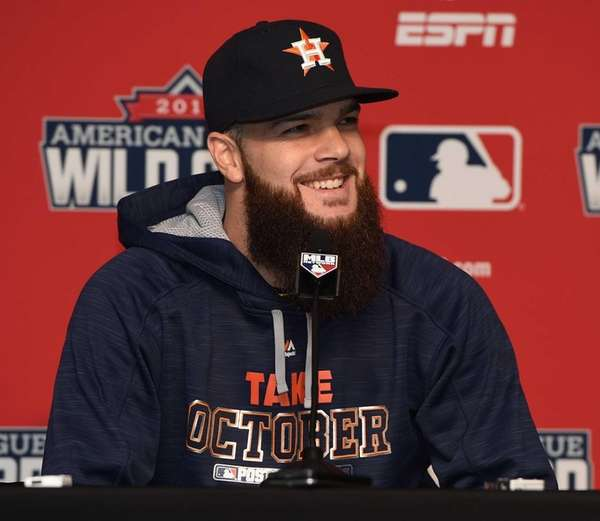 Houston Astros pitcher Dallas Keuchel speaks with the