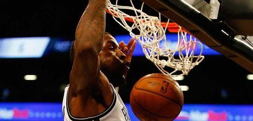 Thomas Robinson #41 of the Brooklyn Nets dunks