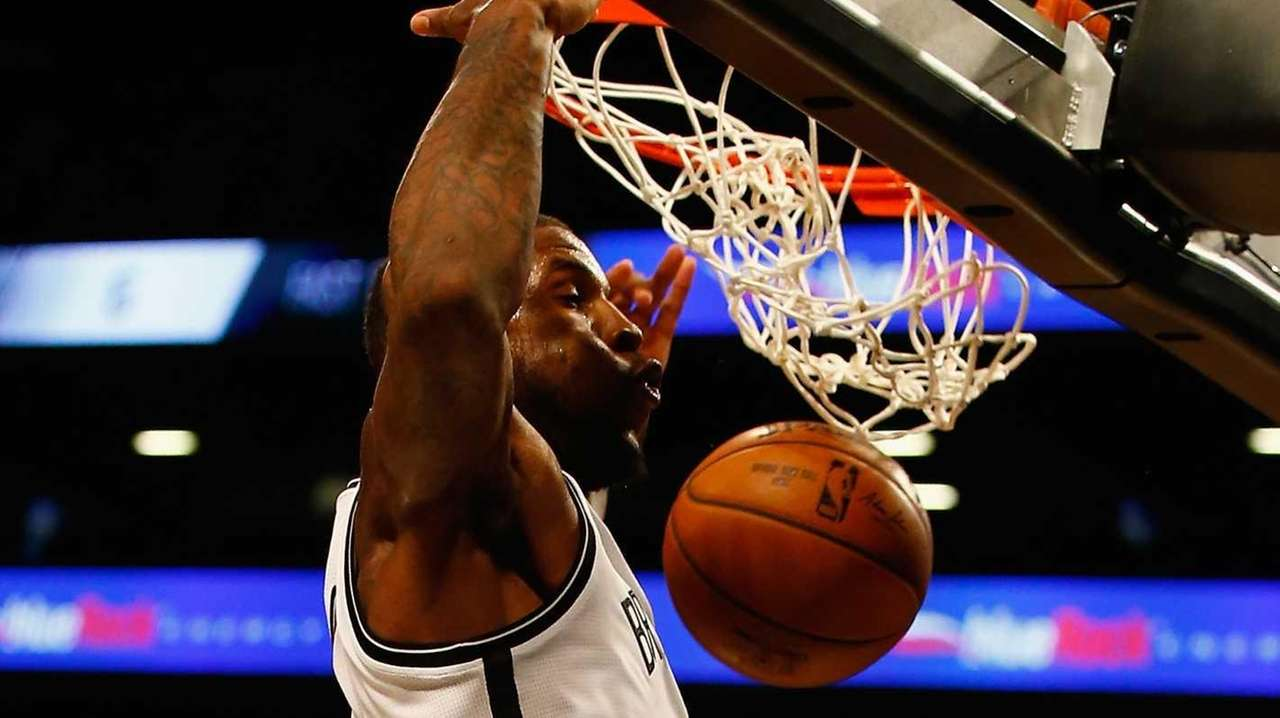 Thomas Robinson #41 of the Brooklyn Nets dunks
