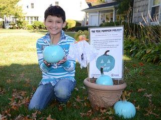 Jonathan Zukoff, 10, of Merrick holds a pumpkin