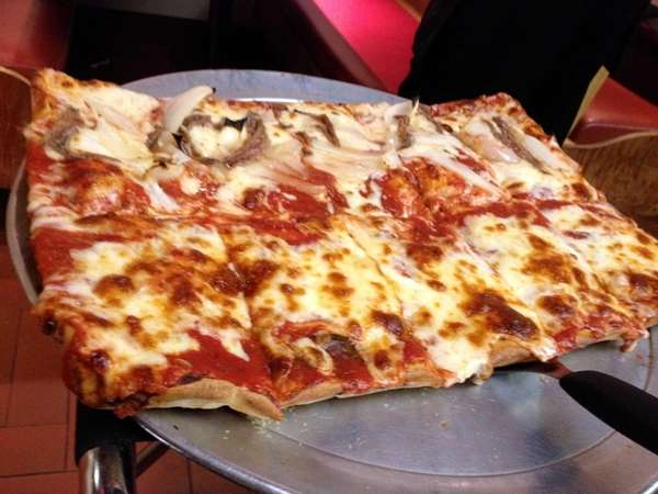 Sicilian pizza, with or without extra toppings, is