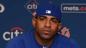 New York Mets outfielder Yoenis Cespedes answers questions