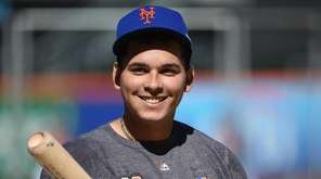 New York Mets shortstop Ruben Tejada looks on