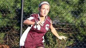Garden City's Isabel Klatt kicks the ball across