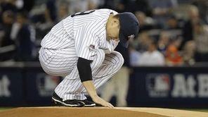 New York Yankees pitcher Masahiro Tanaka touches the