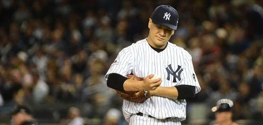 New York Yankees starting pitcher Masahiro Tanaka reacts