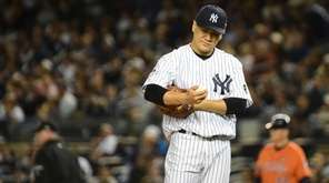 New York Yankees starting pitcher Masahiro Tanaka reacts