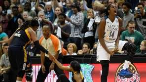 Devereaux Peters #14 of the Minnesota Lynx celebrates