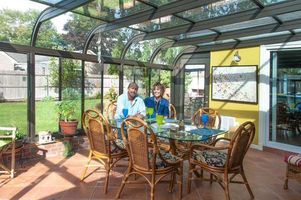 Andy and Kathy Wasko in the all-glass sunroom