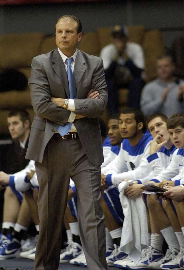 Eastern Illinois head coach Mike Miller walks the