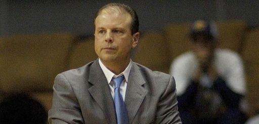 Eastern Illinois head coach Mike Miller walks the