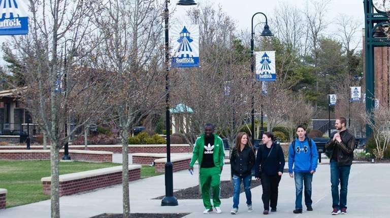 A group of students walks across the campus