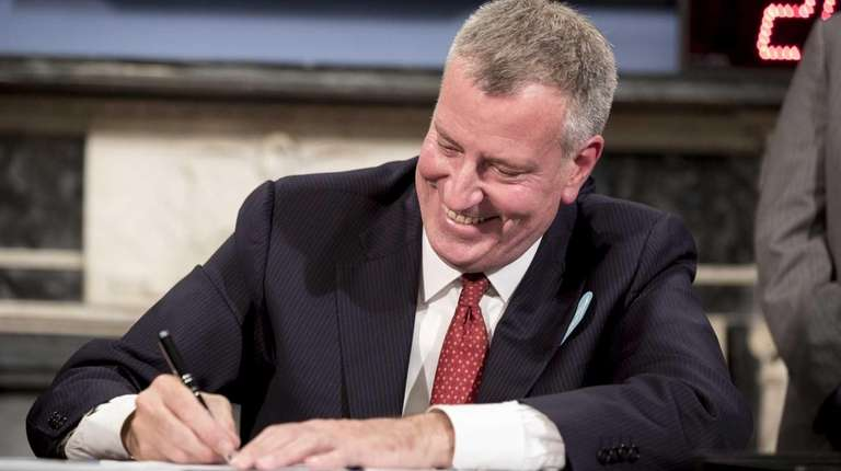 Mayor de Blasio signs a set of bills