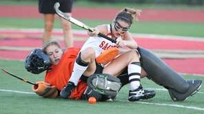 Sachem East's Cara Trombetta (10) falls on top