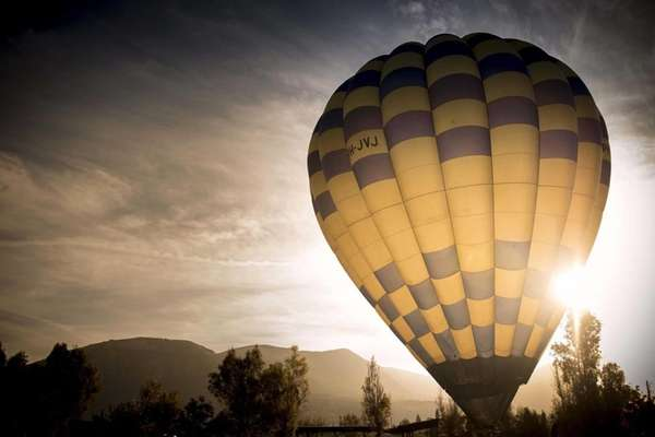 A hot air balloon is prepared for takeoff during the Paestum Balloon Festival in Paestum, Italy on Sunday, Oct. 4, 2015. The festival runs from Oct. 3-11.