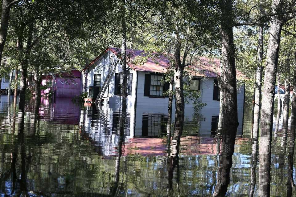 A house is surrounded by floodwater in Givhans,