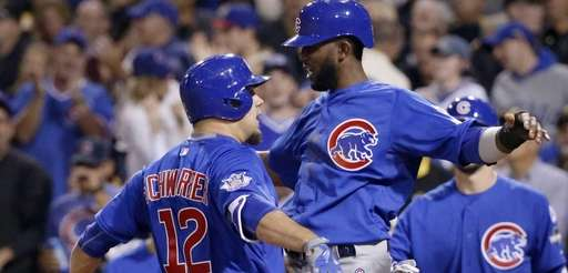 The Chicago Cubs' Kyle Schwarber (12) and Dexter